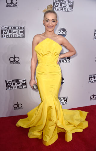 Not a lot of people can pull off canary yellow, but Rita managed it in this showstopper of a gown. Teaming the frankly massive frock with a slicked back top knot and nude lips, she looked oh-so-gorge.