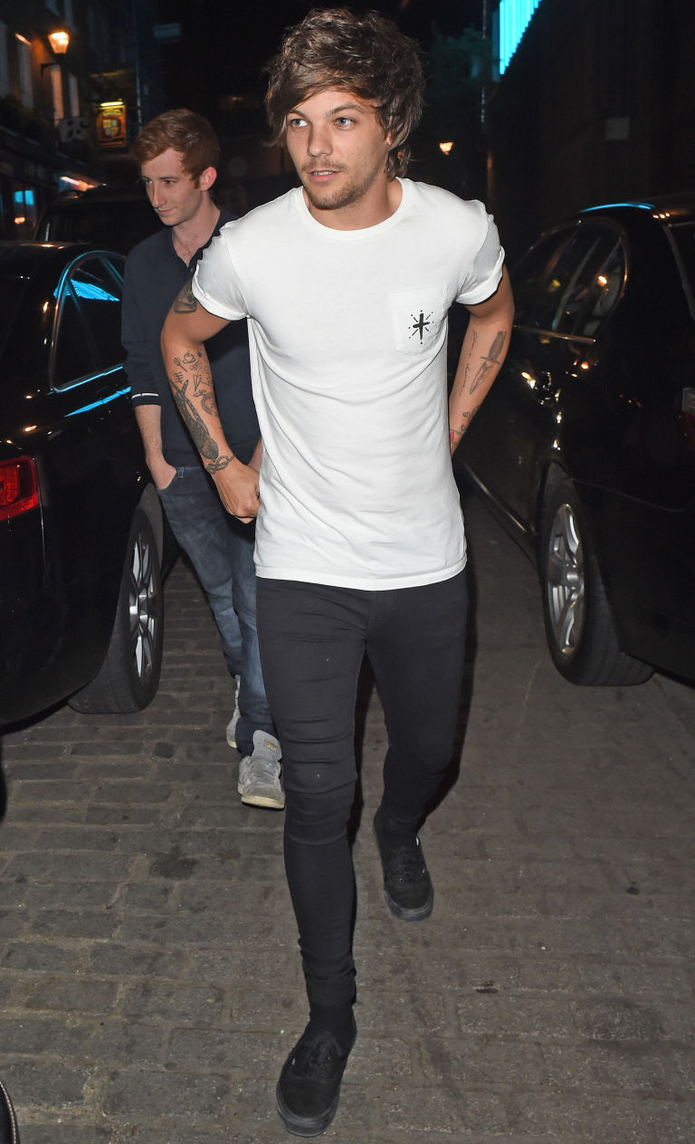 Louis Tomlinson parties at London's Cirque Du Soir again with some female humans